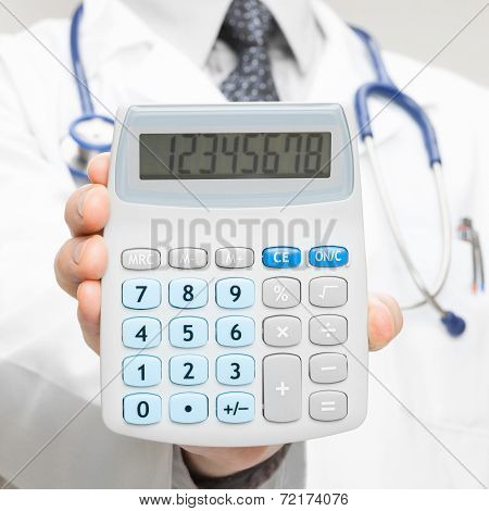 Doctor Holding In His Hand Calculator - Closeup Shot