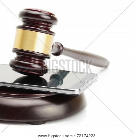 Smartphone Between Judge Gavel And Soundboard Isolated On White Background - Studio Shoot