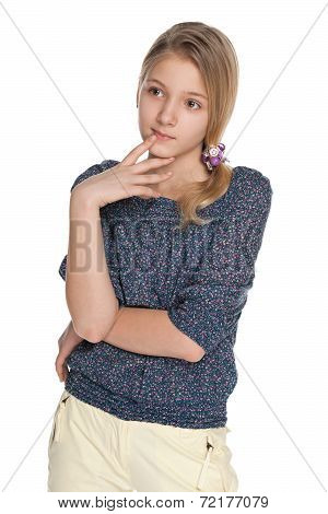 Pensive Preteen Girl On The White Background