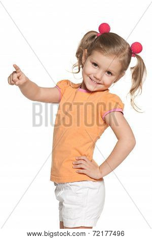 Smiling Girl Shows Her Finger To The Side