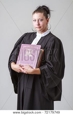 Holding The Book Of Law