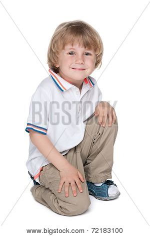Happy Preschool Boy On The White