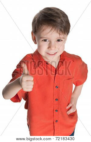 Little Boy In The Red Shirt Holds His Thumb Up