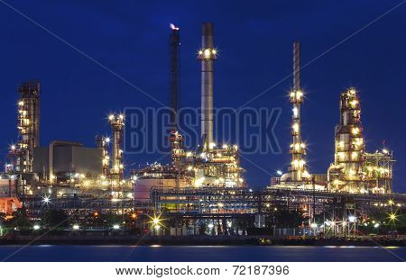 Lighting Of Oil Refinery Plant In Heavy Industry Estate Against Beautiful Dusky Sky Use For Petroche