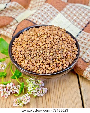 Buckwheat In Brown Bowl With Flower On Board
