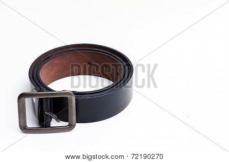 Elegant Man's Black Leather Belt Rolled Up Isolated On White.