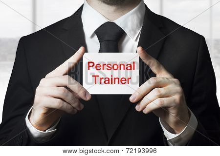 Businessman Holding Sign Personal Trainer