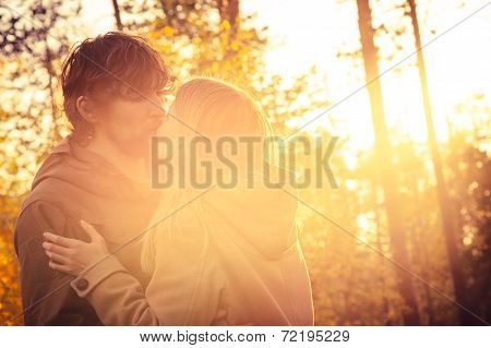 Young Couple Man and Woman Kissing and Hugging in Love