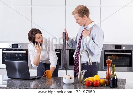 Woman Choosing Tie For Her Partner