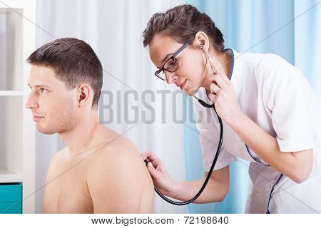 Doctor Auscultating Patient
