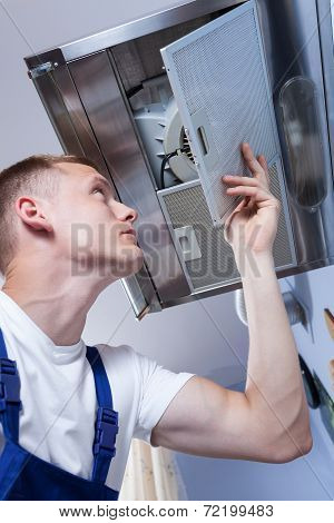 Repairman Fixing Kitchen Extractor Fan