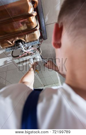 Plumber Fixing Gas Water Heater
