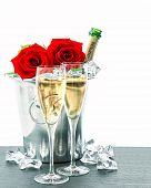 stock photo of sparkling wine  - two glasses bottle of champagne and red roses - JPG