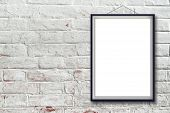 image of wall painting  - Blank vertical painting poster in black frame hanging on white brick wall - JPG