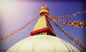 stock photo of nepali  - Vintage filtered picture of Boudhanath Stupa symbol of Kathmandu Nepal - JPG
