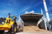 stock photo of power-shovel  - Loader works at bio fuel power co generation station - JPG