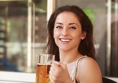 picture of gold tooth  - Laughing woman drinking lager beer in bar - JPG