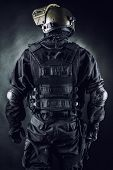 stock photo of anti-terrorism  - Spec ops soldier on black background shot from behind - JPG