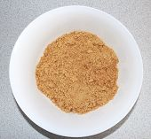 stock photo of homogeneous  - 300 grams of biscuits crushed into a homogeneous light crumb - JPG