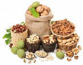 stock photo of mixed nut  - Different nuts in a baskets isolated on white background - JPG