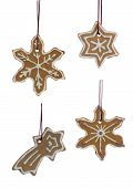 stock photo of ginger bread  - Set of Hanging Ginger Bread Snowflakes Start and a Falling Star Isolated on white - JPG