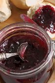 stock photo of home-made bread  - Home made damson or plum jam made with seasonal fruit - JPG