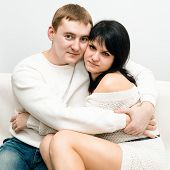 picture of enamored  - enamored couple tenderly embracing on a light background - JPG