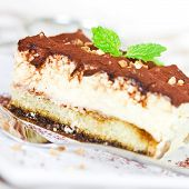 stock photo of peppermint  - tiramisu with peppermint on a plate close up
