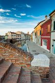 picture of ferrara  - Colorful houses at twilight along a canal in Comacchio - JPG