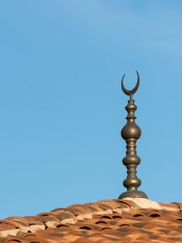 stock photo of crescent-shaped  - Islamic Religion Crescent Moon Sign On Mosque - JPG