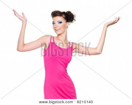 Woman Posing In Pink With Hands Lifted Upwards