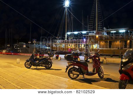 embankment and neon lights bikes boats in Makarska, Crovatia