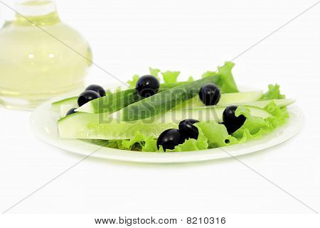 Cucumbers With Olives And Vegetable Butter Are In A Bottle