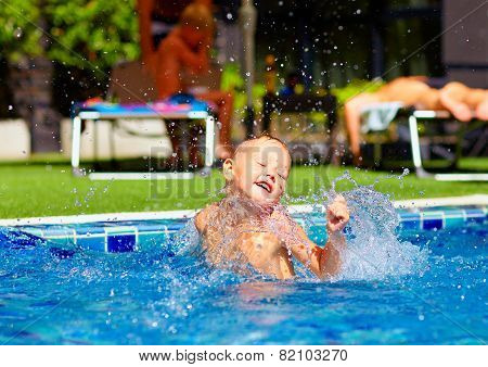 Excited Cute Boy Having Fun In Pool
