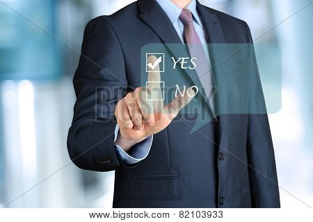 Bisinessman In A Modern Suit Making A Choice By  Hand On A Virtual Form