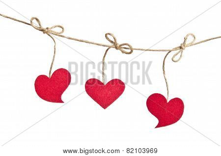 Three Red Fabric Hearts Hanging On The Clothesline Isolated On White Background.