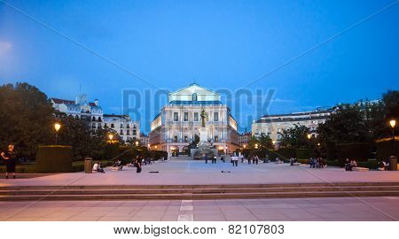 Plaza De Oriente And Royal Theater With Tourists On A Spring Night In Madrid