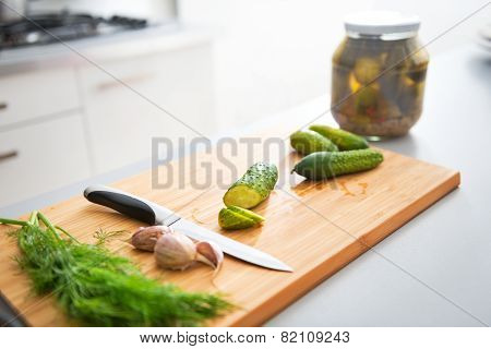 Closeup On Cucumbers Garlic And Dill On Cutting Board
