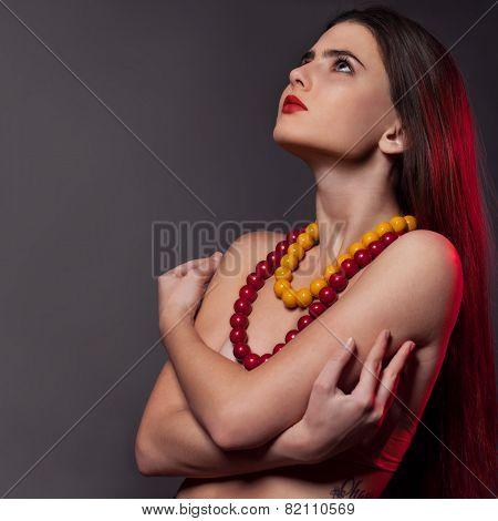 young brunette woman upper body studio shot