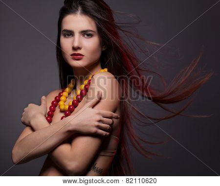 young brunette studio shot dark background