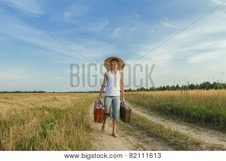 Teenage Traveler With Old Suitcase On Country Road