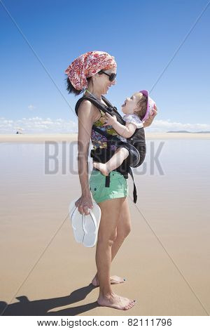 Baby Laughing In Rucksack With Mom