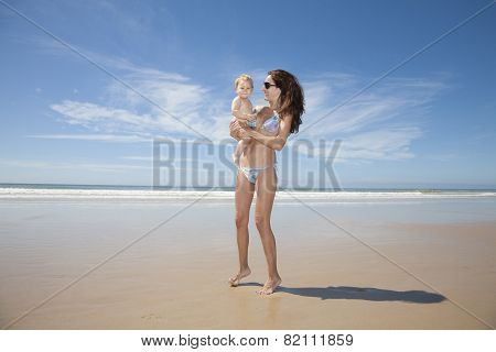 Bikini Mum With Baby At Beach
