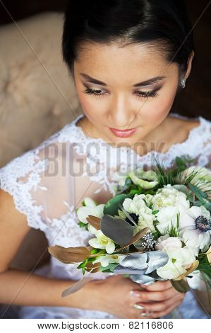 Bride Holding Unusual Wedding Bouquet With Ranunculus