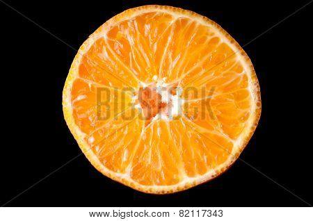 Orange tangerine fruit half slice isolated on black background
