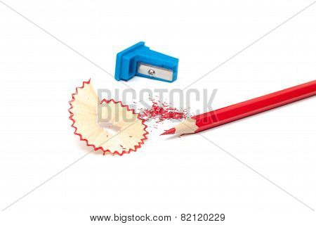 Sharpened pencil, shavings and sharpener