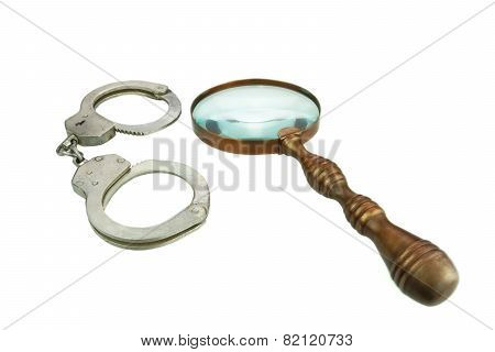 Retro Magnifying Glass And Handcuffs