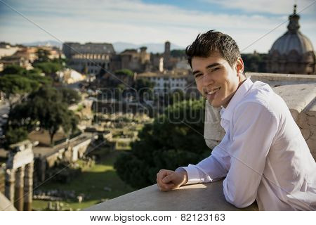 Smiling Young Man Looking at the Outdoor View in Rome, Italy