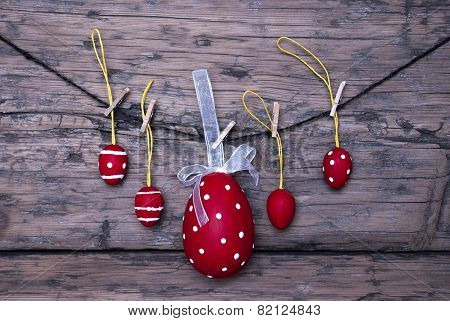Many Red Easter Eggs And One Big Egg Hanging On Line