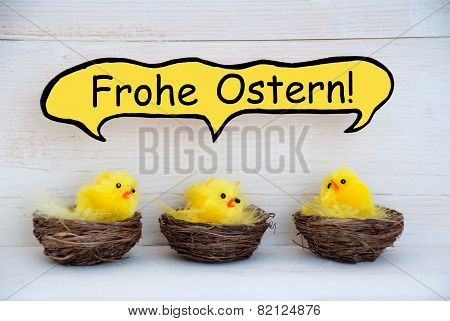 Three Chicks With Comic Speech Balloon German Frohe Ostern Means Happy Easter